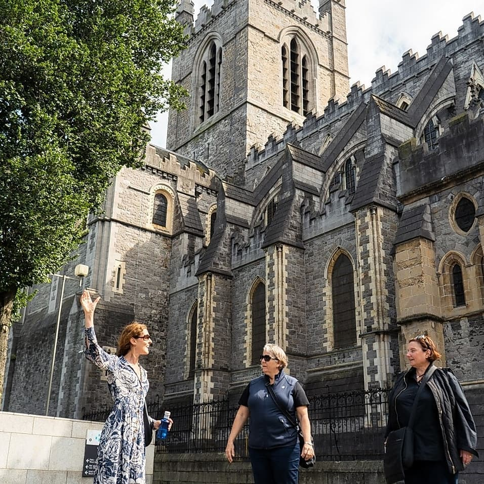 Three ladies are outside Christchurch Cathedral